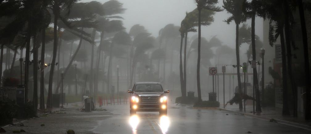 A vehicle drives along Ocean Drive in South Beach as Hurricane Irma arrives at south Florida, in Miami Beach, Florida, U.S., September 10, 2017. REUTERS/Carlos Barria