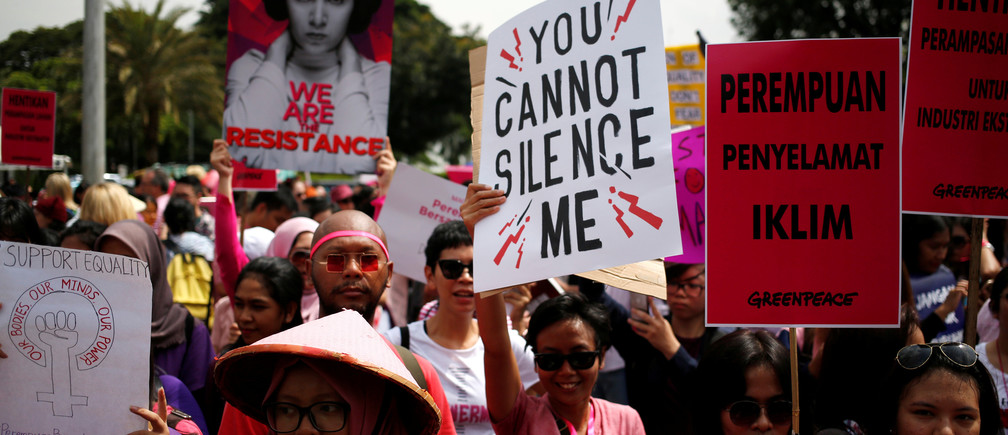 People take part in a rally calling for women's rights and equality ahead of International Women's Day in Jakarta, Indonesia, March 4, 2017. REUTERS/Darren Whiteside - RC12D99D0980