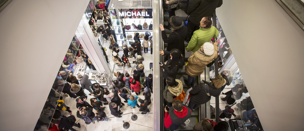 Shoppers enter Macy's to kick off Black Friday sales in New York November 27, 2014.