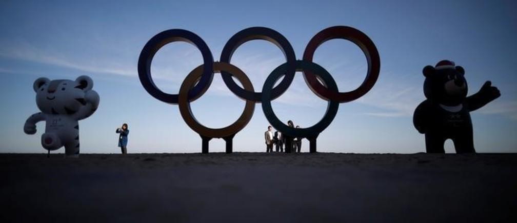 The 2018 PyeongChang Winter Olympics mascot Soohorang, Paralympics mascot Bandabi and the Olympic Rings are displayed at the Gyeongpodae beach in Gangneung, South Korea, October 31, 2017.  REUTERS/Kim Hong-Ji