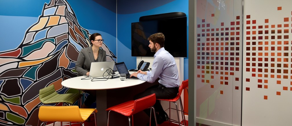 """UBS employees work in the UBS """"fintech lab"""" at Canary Wharf in London, Britain, October 19, 2016."""