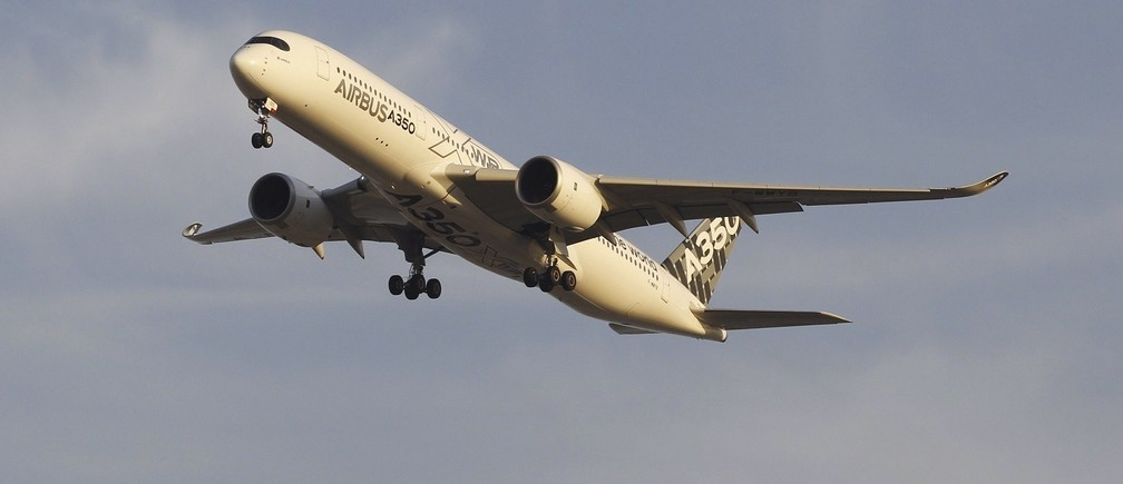 An Airbus A350 XWB aircraft flies over Ataturk International Airport during the Istanbul Airshow in Istanbul September 25, 2014.