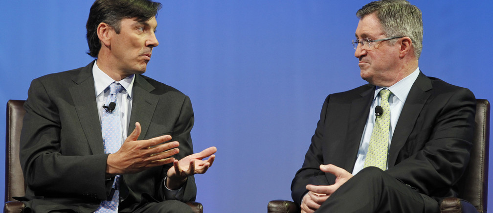 Chairman and CEO of AOL Tim Armstrong (L) speaks to Chairman and CEO of Time Warner Cable Glenn Britt during a panel session at The Cable Show in Boston, Massachusetts May 21, 2012. REUTERS/Jessica Rinaldi (UNITED STATES - Tags: ENTERTAINMENT BUSINESS) - RTR32EZ2