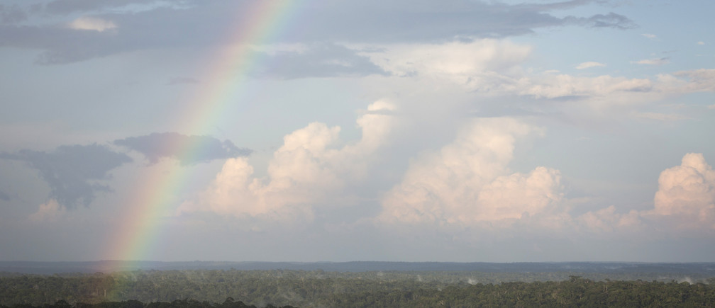 A rainbow is seen from the Amazon Tall Tower Observatory (ATTO) in Sao Sebastiao do Uatuma in the middle of the Amazon forest in Amazonas state January 8, 2015. The Amazon Tall Tower Observatory is a project of Brazil's National Institute of Amazonian Research and Germany's Max Planck Institute and will be equipped with high-tech instruments and an observatory to monitor relationships between the jungle and the atmosphere from next July. According to the institutes, ATTO will gather data on heat, water, carbon gas, winds, cloud formation and weather patterns. Picture taken on January 8, 2015. REUTERS/Bruno Kelly (BRAZIL - Tags: ENVIRONMENT SCIENCE TECHNOLOGY) - GM1EB1D1UHK01