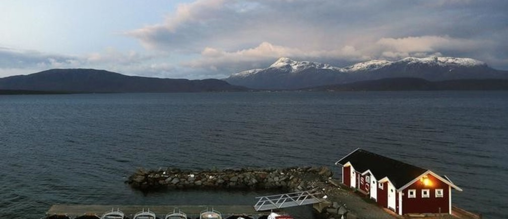 General view of a small harbour and snow-capped mountains in Bals-Fiord, north of the Arctic Circle, near the village of Mestervik in northern Norway September 30, 2014