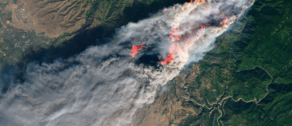 NASA's Operational Land Imager satellite image shows the Camp Fire burning at around 10:45 a.m. local time near Paradise, California, U.S., on November 8, 2018. Picture taken on November 8, 2018.  Courtesy NASA/Handout via REUTERS   ATTENTION EDITORS - THIS IMAGE HAS BEEN SUPPLIED BY A THIRD PARTY. - RC1BB8BD0470