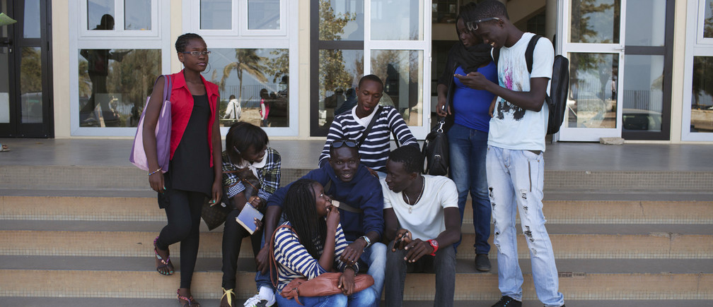 Students hang out on the steps of a university building during a strike at Cheikh Anta Diop University, in Dakar April 10, 2013.