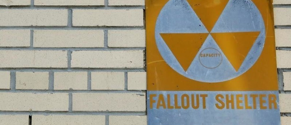 A yellow nuclear fallout shelter sign is seen hung on a building in the Brooklyn borough of New York, U.S., December 7, 2017. Picture taken December 7, 2017.  REUTERS/Brendan McDermid - RC1DC2DBA9A0