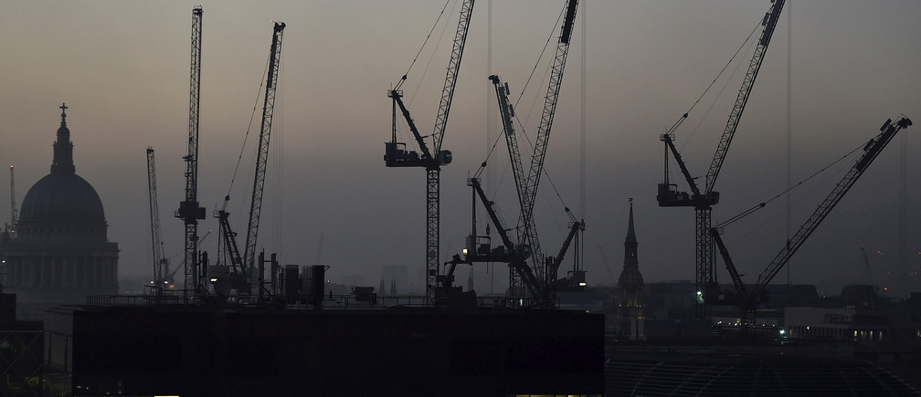 Offices are seen at dusk as St. Paul's cathedral and construction cranes are seen on the skyline in the City of London, Britain November 2, 2015.   REUTERS/Toby Melville/File Photo                       GLOBAL BUSINESS WEEK AHEAD PACKAGE - SEARCH 'BUSINESS WEEK AHEAD 24 OCT'  FOR ALL IMAGES - RTX2Q53S