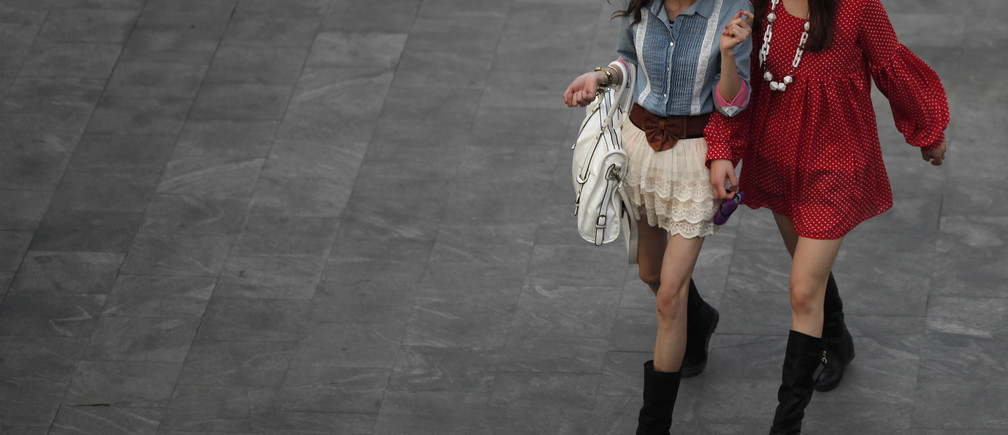 Women walk in the financial area of Pudong in Shanghai April 26, 2011. REUTERS/Carlos Barria  (CHINA - Tags: SOCIETY) - GM1E74Q1IVV01