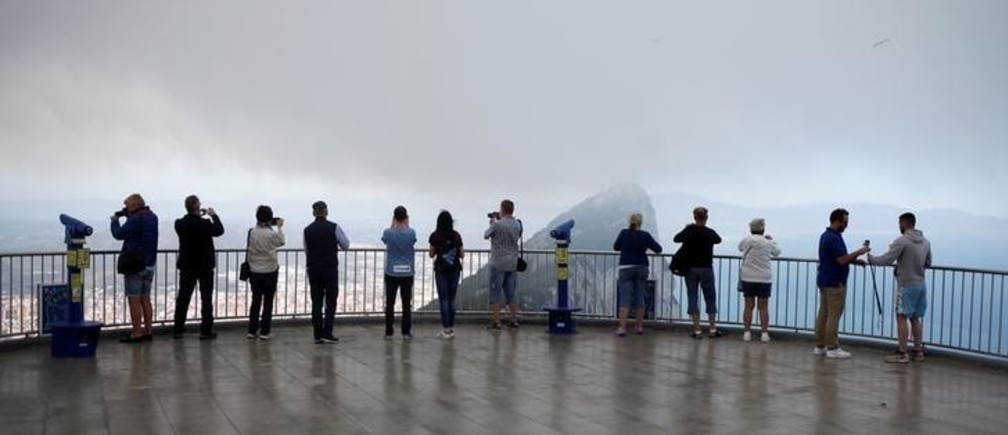 Tourists take photographs at a terrace on the top of the Rock in the British overseas territory of Gibraltar, historically claimed by Spain April 18, 2018. REUTERS/Jon Nazca