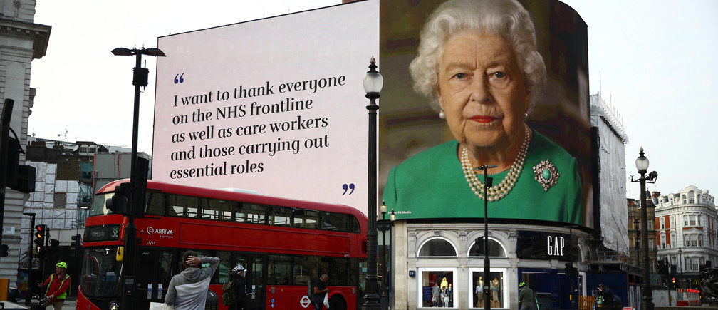 A message from Britain's Queen Elizabeth II is displayed on a screen in Piccadilly Circus, as the spread of the coronavirus disease (COVID-19) continues, London, Britain, April 8, 2020. REUTERS/Hannah McKay - RC2H0G97UND5