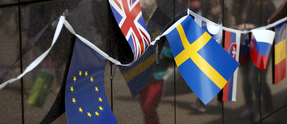 A Union Flag flutters next to a European Union (EU) flag, and other flags of EU countries on Open Doors Day of the EU institutions in Brussels, Belgium May 9, 2015.