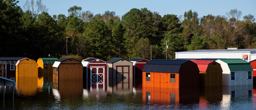 Sheds sit in flooded waters due to Hurricane Florence, now downgraded to a tropical depression, in Kinston, North Carolina, U.S., September 19, 2018. REUTERS/Eduardo Munoz - RC1810F5B2E0