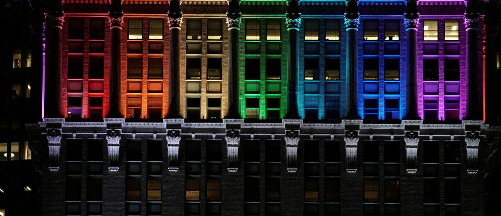 The Helmsley Building is lit in rainbow color ahead of the 50th anniversary of the Stonewall riot, in New York, U.S., June 24, 2019.  REUTERS/Gabriela Bhaskar     TPX IMAGES OF THE DAY - RC150741C9B0