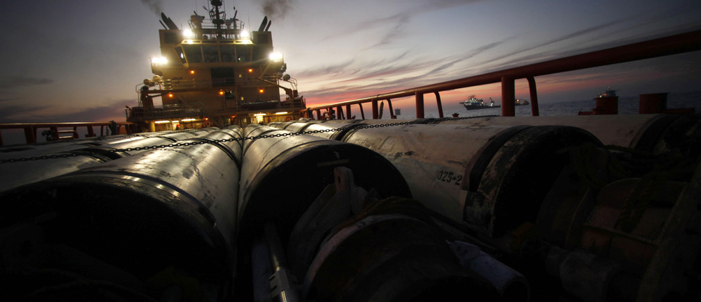 Risers, the outer casings of oil drill pipes, are seen on the deck of the service vessel Joe Griffin as it prepares to head to Port Fouchon at the site of the Deepwater Horizon oil spill in the Gulf of Mexico, off the coast of Louisiana, May 11, 2010.