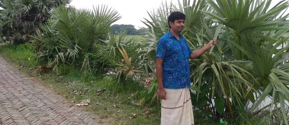 Ghior elected representative Abdul Baten stands near young palm trees along a village road in central Bangladesh September 1, 2019.