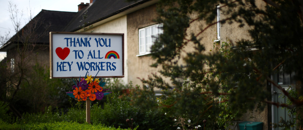 A sign thanking key workers is seen, as the spread of the coronavirus disease (COVID-19) continues, in Herne Hill, London, Britain March 30, 2020. REUTERS/Hannah McKay - RC27UF9X897H