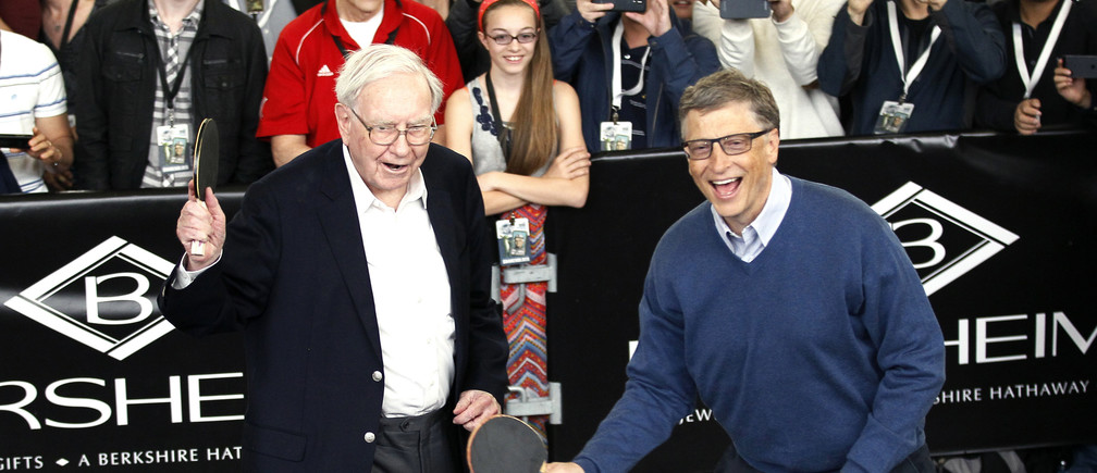 "Berkshire Hathaway CEO Warren Buffett (L) and friend Bill Gates, founder of Microsoft, play table tennis at a Berkshire sponsored reception in Omaha, Nebraska May 4, 2014 as part of the company annual meeting weekend. The investment guru was peppered with questions at the meeting, part of a mostly festive weekend that Buffett calls ""Woodstock for Capitalists,"" following concerns that Berkshire last year missed Buffett's five-year growth target for the first time in his 49 years at the helm. REUTERS/Rick Wilking  (UNITED STATES - Tags: BUSINESS TPX IMAGES OF THE DAY) - GM1EA5509UY01"