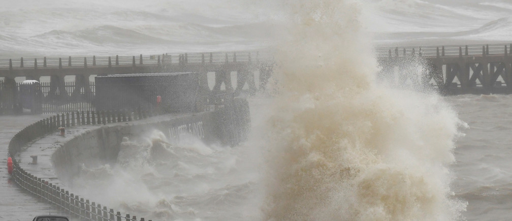 Large waves and sea spray caused by Storm Ciara hit vehicles being driven along the seafront in Newhaven Weather extreme storm hurricane typhoon flooding flood floods danger rain wind windy rainy flash floods