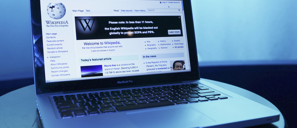 Wikipedia webpage in use on a laptop computer is seen in this photo illustration taken in Washington, January 17, 2012. Wikipedia, the popular community-edited online encyclopedia, will black out its English-language site for 24 hours to seek support against proposed U.S. anti-piracy legislation that Wikipedia founder Jimmy Wales said threatens the future of the Internet. REUTERS/Gary Cameron