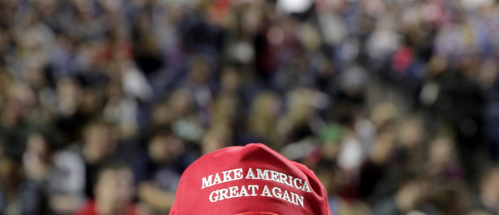 "A supporter of U.S. Republican presidential candidate Donald Trump wears a ""Make America Great Again"" cap before his speech at Liberty University in Lynchburg, Virginia, January 18, 2016.      REUTERS/Joshua Roberts - RTX22Y49"