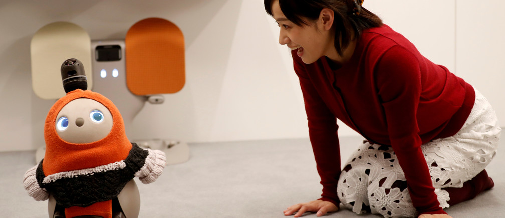 A woman calls up GROOVE X's new home robot LOVOT at its demonstration during the launching event in Tokyo, Japan, December 18, 2018. REUTERS/Kim Kyung-Hoon     TPX IMAGES OF THE DAY - RC1BAD9B5D00