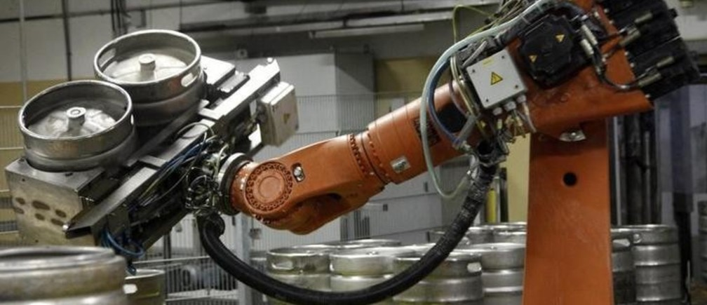 A mobile robot lifts empty beer barrels in the Ottakringer brewery in Vienna June 9, 2010. Ottakringer is one of Austria biggest brewers and produces 620,000 hectolitres of beer per year.  REUTERS/Leonhard Foeger  (AUSTRIA - Tags: BUSINESS)