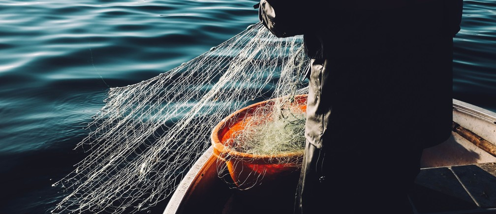 A fisherman hauls in his catch.