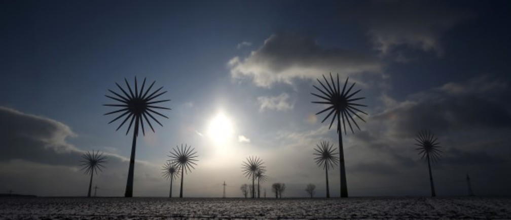 Wind turbines are pictured in this multiple exposure at the German village of Feldheim February 21, 2013. Feldheim, a 60-minute drive south of Berlin and home to about 125 people, is Germany's first and only energy self-sufficient village. Germany is a world leader in renewable energy and derives a quarter of its electricity from renewables, but rising prices have turned into a major political issue ahead of the election. Picture taken February 21, 2013. REUTERS/Tobias Schwarz
