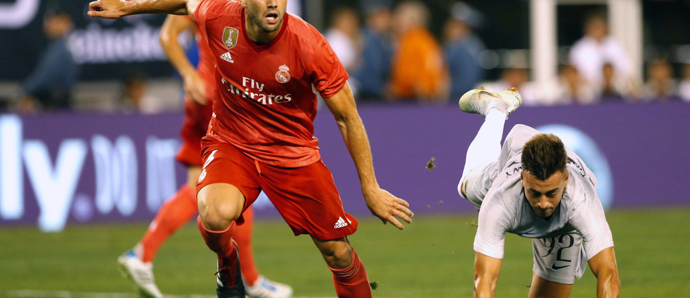 Aug 7, 2018; East Rutherford, NJ, USA; Real Madrid defender Nacho (6) and Roma forward Stephan El Shaarawy (92) battle for the ball during an International Champions Cup soccer match at MetLife Stadium. Mandatory Credit: Noah K. Murray-USA TODAY Sports - 11042176