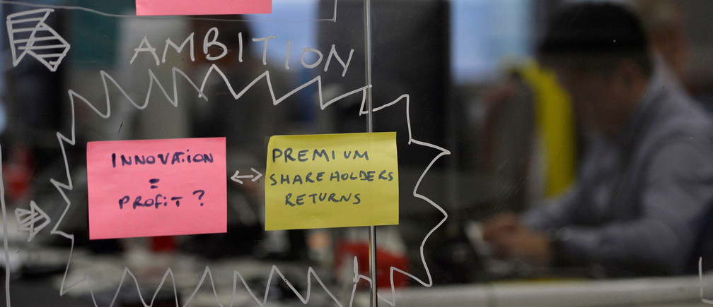 "Post-it notes are displayed in the UBS ""fintech lab"" at Canary Wharf in London, Britain, October 19, 2016. REUTERS/Hannah McKay - RTX2PJIX"
