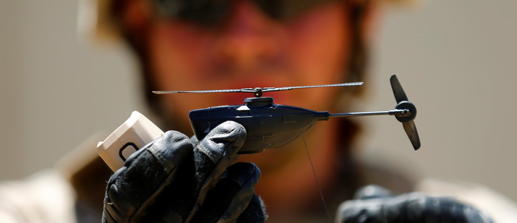 A U.S. Marine shows off a Grp I UAS Black Hornet Drone as part of the Rim of the Pacific (RIMPAC) 2016 exercise held at Camp Pendleton, California United States, July 13, 2016.    REUTERS/Mike Blake  - S1AETPKVRGAD