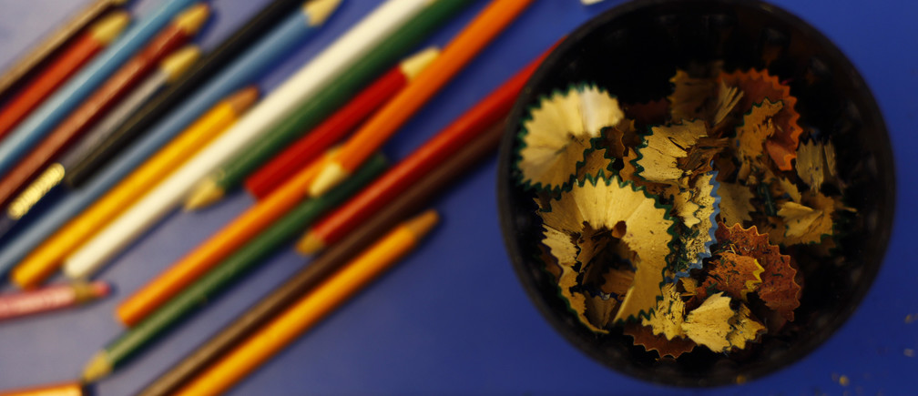 Pencils and pencil shavings are seen on a desk at Watlington Primary School in Watlington, southern England December 14, 2011. On Thursday the Department of Education will publish primary school league tables.     REUTERS/Eddie Keogh (BRITAIN - Tags: POLITICS EDUCATION) - LM1E7CE14WN01