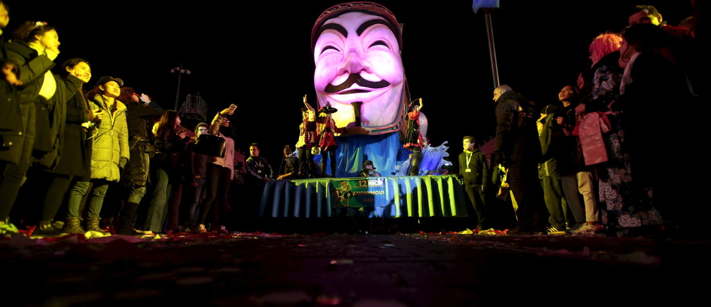 "The float with a giant Guy Fawkes mask (aka Anonymous mask) is paraded through the crowd during the Carnival parade in Nice, France, February 13, 2016. The 132 nd Carnival of Nice will take place from February 13 to 28 and will celebrate the ""King of Media""."