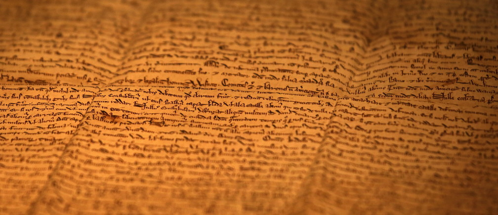 """One of the few surviving copies of Magna Carta, Latin for """"The Great Charter"""" written in 1217 on sheep skin is displayed at an exhibition in Hong Kong, China, November 10, 2015. The exhibition is part of a worldwide celebrations of its 800th anniversary, British Consulate in Hong Kong said. REUTERS/Bobby Yip - GF20000052667"""