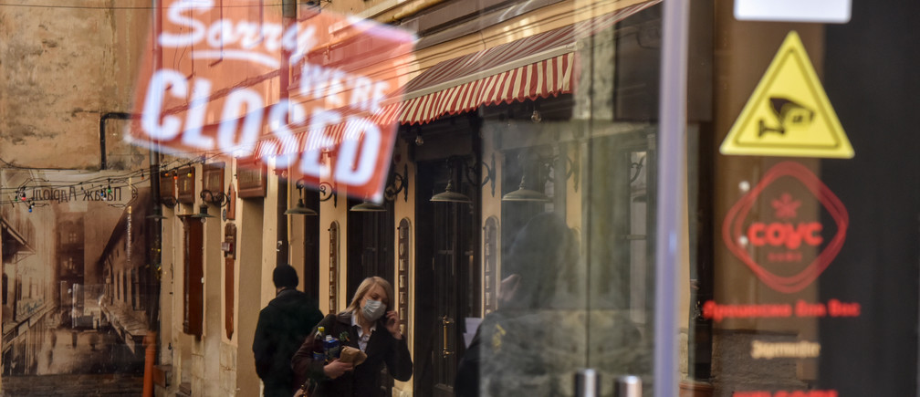 A woman wearing protective mask is reflected in a window of a closed shop, amid coronavirus (COVID-19) concerns, in Lviv, Ukraine March 16, 2020. women business businesswoman businessman corporation corporate finance wall street stock exchange capitalism private ownership board c-suite CEOs CFOs corporation united states us america wall street change gender parity equality goldman sachs davos industry representation fair finance fiscal financial economics economies trading trade price money profit value men male female change changing 2020 future taxation tax wealth gross domestic product gdp environment renewable solar energy change transition friendly environment carbon footprint carbon emissions reduction change natural climate change global warming air pollution clean energy power renewables plastic plastics Coronavirus china virus health healthcare who world health organization disease deaths pandemic epidemic worries concerns Health virus contagious contagion viruses diseases disease lab laboratory doctor health dr nurse medical medicine drugs vaccines vaccinations inoculations technology testing test medicinal biotechnology biotech biology chemistry physics microscope research influenza flu cold common cold bug risk symptomes respiratory china iran italy europe asia america south america north washing hands wash hands coughs sneezes spread spreading precaution precautions health warning covid 19 cov SARS 2019ncov wuhan sarscow wuhanpneumonia  pneumonia outbreak patients unhealthy fatality mortality elderly old elder age serious death deathly deadly