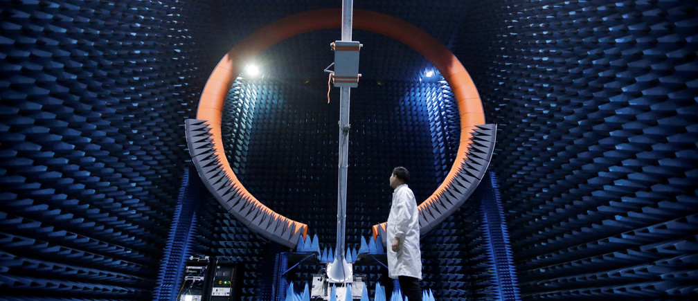 An engineer stands under a base station antenna of 5G in Huawei's SG178 multi-probe spherical near-field testing system at its Songshan Lake Manufacturing Center in Dongguan, Guangdong province, China May 30, 2019. Picture taken May 30, 2019. REUTERS/Jason Lee     TPX IMAGES OF THE DAY - RC1B87A91DB0