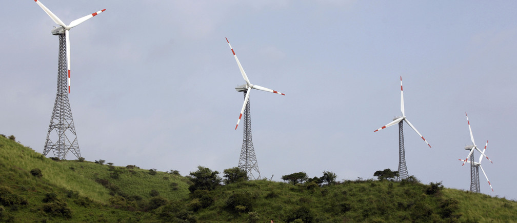 Power-generating windmill turbines are pictured in Suzlon wind farm at Sanodar village, 160 km (99 miles) west of the western Indian city of Ahmedabad, September 8, 2009. =