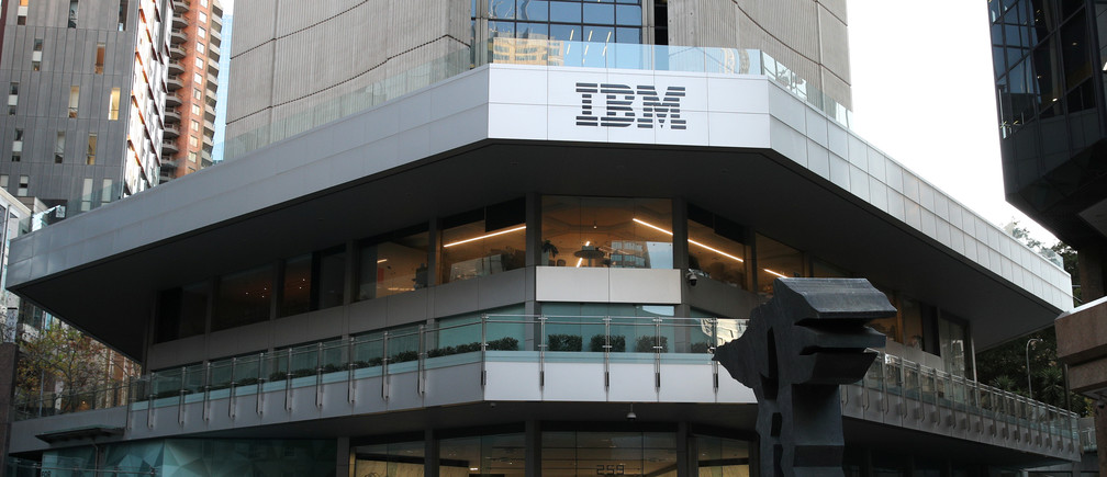 A man wearing a protective mask walks past an office building with IBM logo amidst the easing of the coronavirus disease (COVID-19) restrictions in the Central Business District of Sydney, Australia, June 3, 2020. Picture taken June 3, 2020.