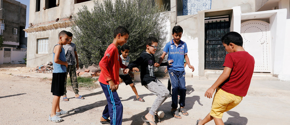 Boys play near the house of Fakher Hmidi, a young man who still unaccounted for after last week's capsizing off the Italian island of Lampedusa, in Thina district of Sfax, Tunisia October 15, 2019. Picture taken October 15, 2019. REUTERS/Zoubeir Souissi - RC1F5E3D2A50