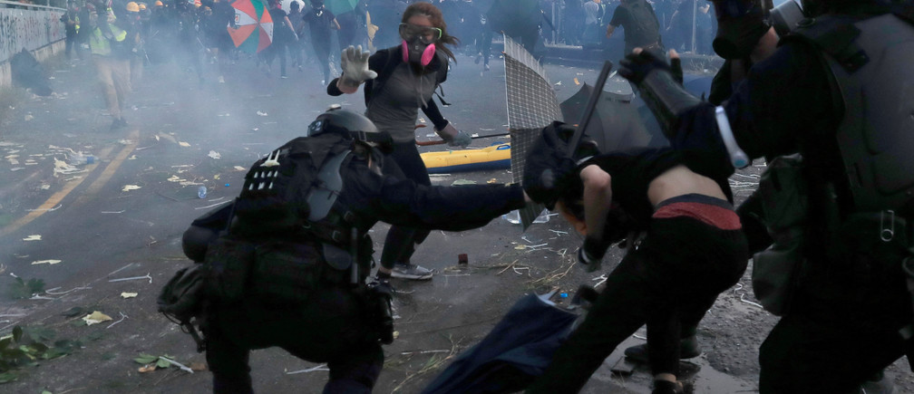 Riot police clash with anti-government protesters during a demonstration in Sha Tin district, on China's National Day in Hong Kong, China October 1, 2019