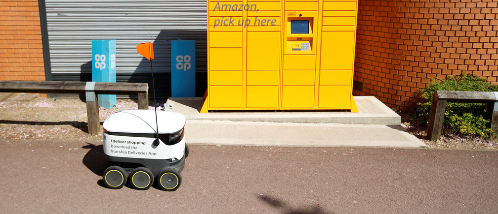 A delivery robot from the company ''Starship'' is seen, as the spread of the coronavirus disease (COVID-19) continues, in Milton Keynes, Britain, April 21, 2020. REUTERS/Andrew Boyers - RC229G9I8TWQ