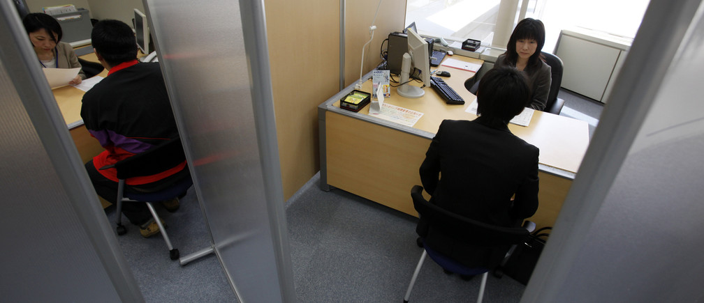 A Japanese new graduate, who wishes to be called Shinji (R), speaks with a counsellor inside a compartment at Tokyo Metropolitan Government Labor Consultation Center in Tokyo in this April 8, 2010 file photo. Japan already has one Lost Generation of youth stuck in insecure jobs as part-timers, contract workers and temps after failing to find steady employment when they graduated from high school or college during a hiring Ice Age from 1994 to 2004. Now the country's leaders worry that a still-fragile recovery from Japan's worst recession in 60 years and cautious corporate hiring plans are putting a second batch of youth at risk, raising prospects of a further waste of human resources the country can ill afford as it struggles with an ageing, shrinking population. Picture taken April 8, 2010.   To match feature JAPAN-GENERATION/    REUTERS/Yuriko Nakao (JAPAN - Tags: BUSINESS EMPLOYMENT SOCIETY POLITICS) - GM1E64M0M7201