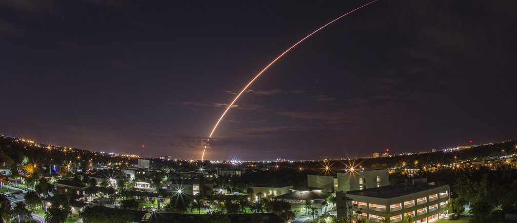 A United Launch Alliance Atlas V 551 rocket blasts off from Cape Canaveral Air Force Station in Florida, January 20, 2015. The unmanned rocket blasted off with a next-generation communications satellite designed to provide cellular-like voice and data services to U.S. military forces around the world. Picture taken using long exposure, looking over the campus of Florida Institute of Technologies in Melbourne, about 40 miles from the launch pad. REUTERS/Michael Brown  (UNITED STATES - Tags: SCIENCE TECHNOLOGY MILITARY TPX IMAGES OF THE DAY) - GM1EB1L0SXU01