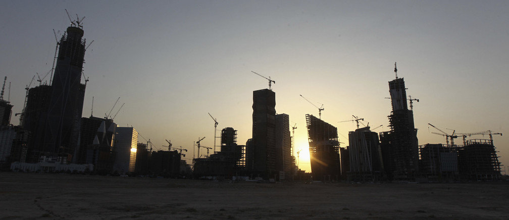 A view of the King Abdullah Financial District in the Saudi capital Riyadh at sun set October 9, 2013. The district, currently under construction, is planned to consist of 42 buildings offering 900,000 square metres of office space, according to local media reports. REUTERS/Faisal Al Nasser (SAUDI ARABIA - Tags: BUSINESS CITYSCAPE REAL ESTATE CONSTRUCTION) - GM1E9AA01B702