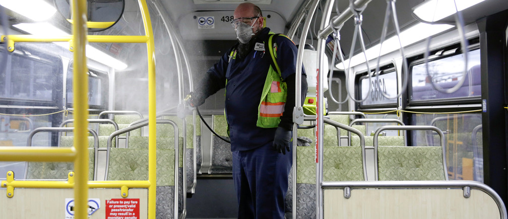 Raymond Determann, a King County Metro equipment service worker, sprays a Virex solution to sanitize buses against the coronavirus in Seattle, Washington, U.S. March 5, 2020. REUTERS/Jason Redmond - RC23EF9SGN94