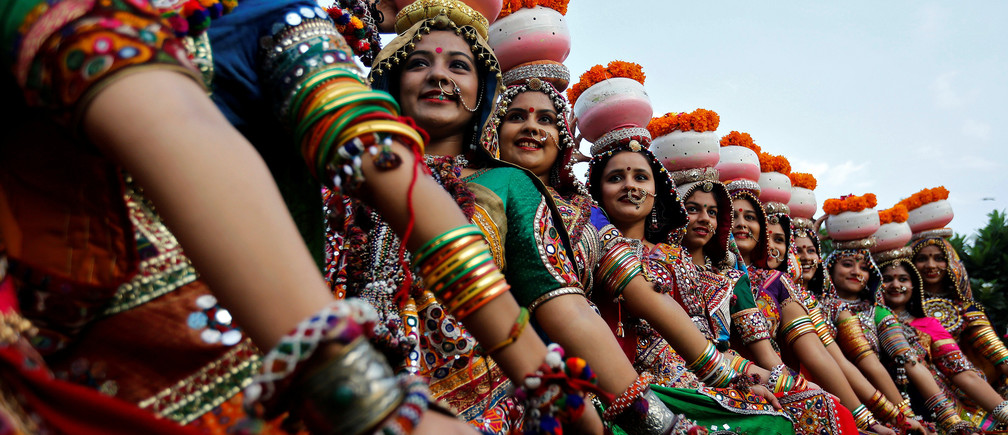 Women dressed in traditional attire pose after taking part in rehearsals for Garba, a folk dance, ahead of Navratri, a festival when devotees worship the Hindu goddess Durga, in Ahmedabad, India, September 25, 2016. REUTERS/Amit Dave     TPX IMAGES OF THE DAY      - S1BEUDHASCAB