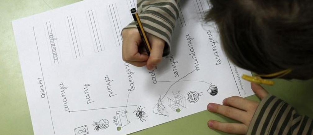 A pupil does handwriting exercises during a language class at a public school in El Masnou, near Barcelona, December 14, 2012. Spain's leader vowed on Friday to press on with an education reform that has fueled separatist sentiment in Catalonia, where politicians were closing on a pact that could lead to a vote on independence. REUTERS/Albert Gea (SPAIN - Tags: POLITICS EDUCATION) - GM1E8CF03RR01