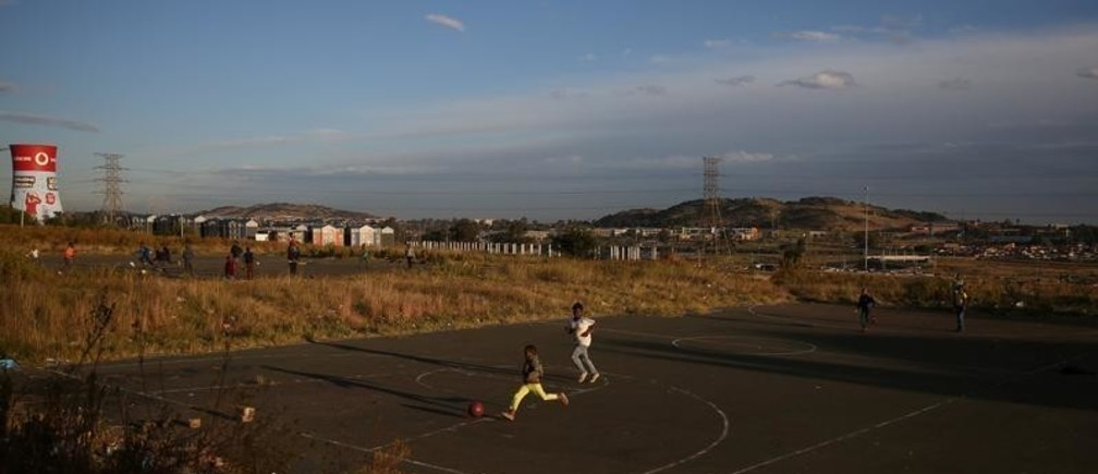 Boys play soccer at a makeshift pitch in Soweto, South Africa, May 14, 2018.